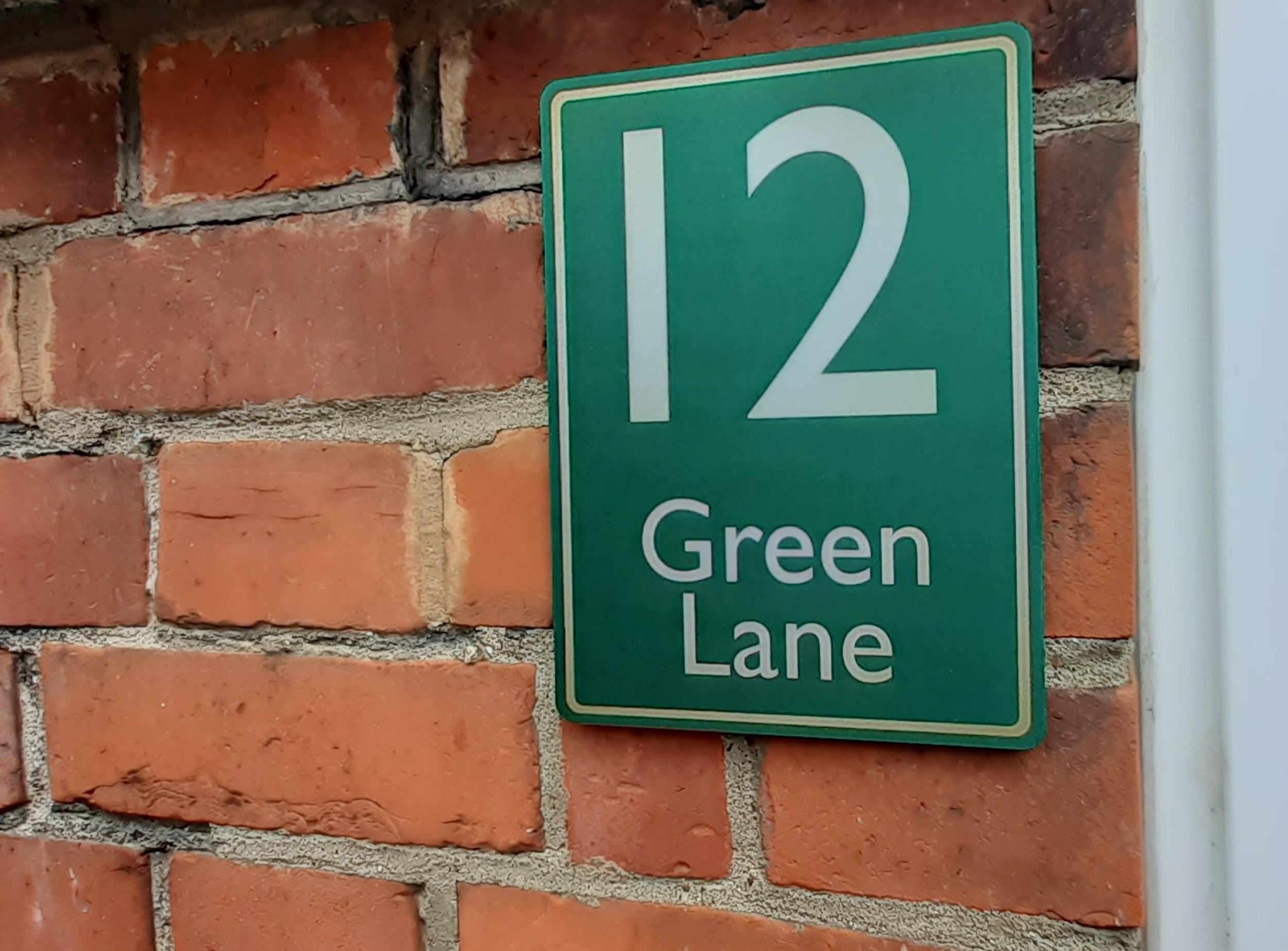 Green brass house sign